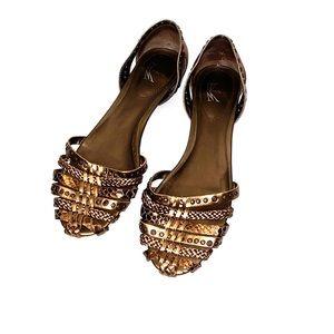 Leather copper Ballerina sandals.